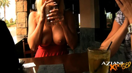 Hot beautiful blonde, Angie Savage, sits on the restaurant patio with sexy Rachel Aziani and has fun flashing her big tits for the camera! from Aziani Xposed